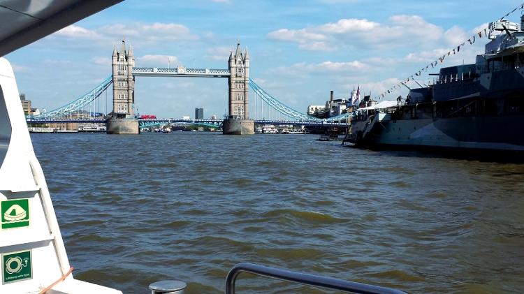Boat tour on River Thames on a sunny day