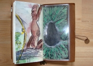 On this end of the zip-lock pocket insert is an old art work of mine of a kiwi. Media used: ink and oil pastels